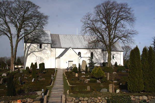 The Jelling Church with the Jellingestenene in front