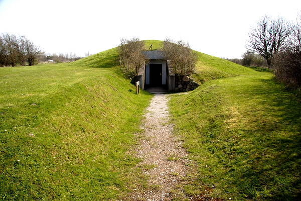 The entrance into the burial mound and the viking ship grave in Ladby