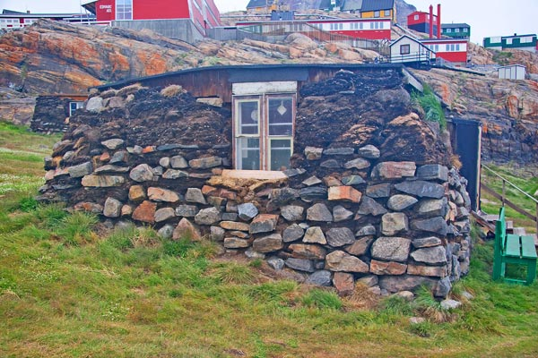 A pit house in Uummannaq, Greenland, dug partly into the ground