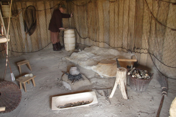 The inside of a Hedeby house reconstruction showing fishing equipment